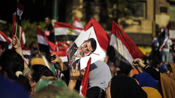 Egyptian opposition protesters celebrate on July 1, 2013 in Cairo.(AFP Photo / Gianluigi Guercia)