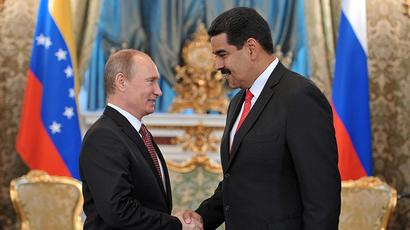 Russian President Vladimir Putin, left, and Nicolas Maduro Moros, President of the Bolivarian Republic of Venezuela, greet each other during a meeting in the Grand Kremlin Palace, July 2, 2013. (RIA Novosti / Aleksey Nikolskyi)