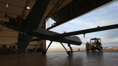 Maintenence personel tow out a Predator drone operated by U.S. Office of Air and Marine (OAM), before its surveillance flight near the Mexican border.(AFP Photo / John Moore)