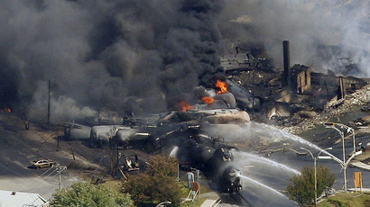 The wreckage of a train is pictured after an explosion in Lac Megantic July 6, 2013. (Reuters/Mathieu Belanger)