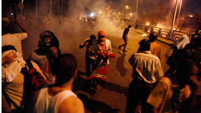 Egyptian supporters of the Muslim Brotherhood rallying in support of deposed president Mohamed Morsi clash with police outside the elite Republican Guards base in Cairo early on July 8, 2013 (AFP Photo / Mahmoud Khaled)