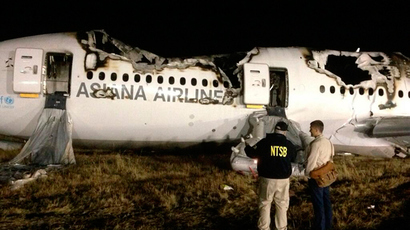 National Transportation Safety Board (NTSB) investigators conduct first site assessment of the wreckage of Asiana Airlines Flight 214, at San Francisco International Airport in San Francisco, California in this July 6, 2013 handout photo (Reuters / NTSB / Handout via Reuters)