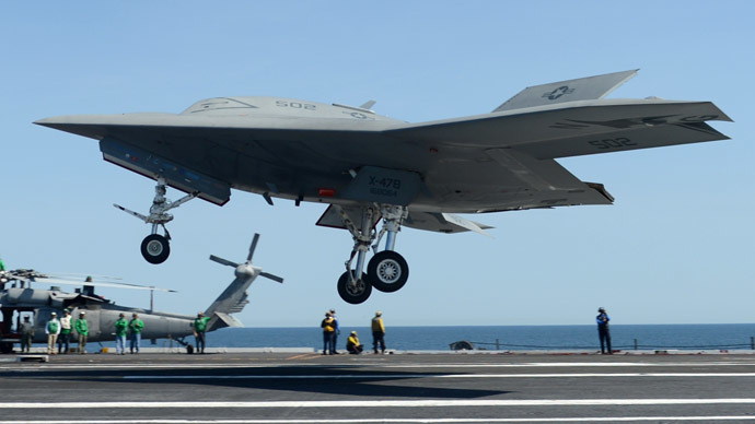 This photo released by the US Navy shows an X-47B unmanned combat air system (UCAS) demonstrator preparing to execute a touch and go landing on May 17, 2013 on the flight deck of the aircraft carrier USS George H.W. Bush (CVN 77)in the Atlantic Ocean. (AFP Photo/US Navy)