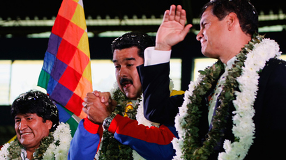 Bolivia's President Evo Morales (L) and his counterparts Nicolas Maduro (C) of Venezuela and Rafael Correa of Ecuador greet the crowd during a welcoming gathering in honor of Morales, in Cochabamba, on July 4, 2013. (AFP Photo)