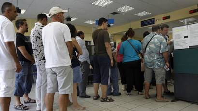 People line up inside an unemployment bureau in Athens (Reuters/John Kolesidis)