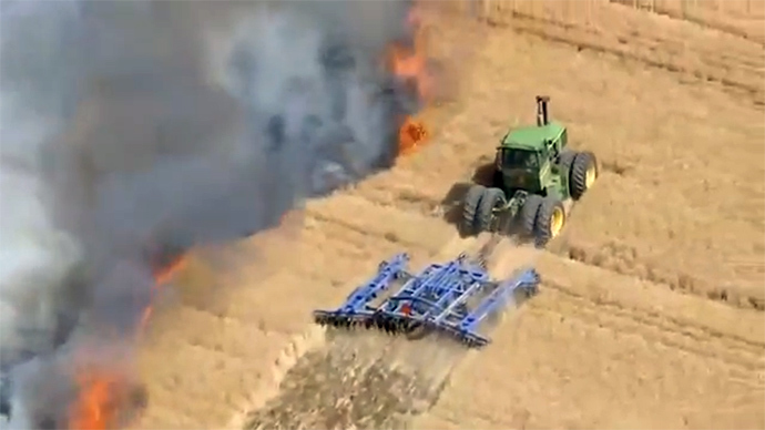 Farmer risks his life to stop wildfire with tractor (VIDEO)