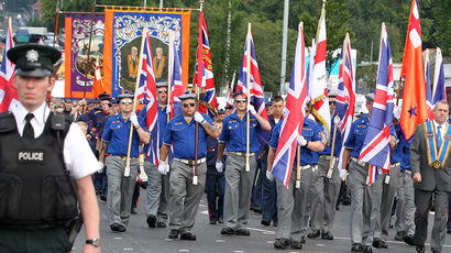 Orangemen from the Ligoniel Lodges march past the Nationalist Ardoyne area of North Belfast, in Northern Ireland, on July 12, 2012 (AFP Photo / Peter Muhly)