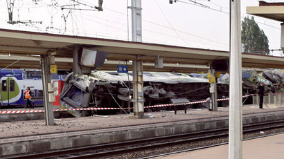 A picture shows a derailed wagon on the site of a train accident in the railway station of Bretigny-sur-Orge on July 12, 2013 near Paris.(AFP Photo / Kenzo Tribouillard)