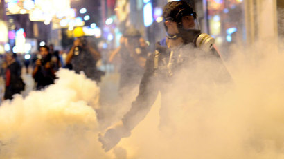A protestor holds a tear gas bullet as they clash with Turkish riot policemen on July 13, 2013 on Istiklal Avenue in the center of Istanbul.(AFP Photo / Bulent Kilic)