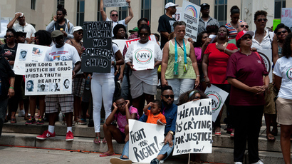 People demonstrate in Washington on July 20, 2013, one week after the acquittal of George Zimmerman (AFP Photo / Nicholas Kamm)