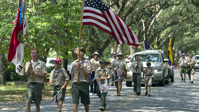 A Boy Scout troop marches under the live oak trees on Oak Avenue (Reuters / Ray Stubblebine)