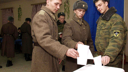 Conscripts of No. 495 rescue center of Russia's Emergency Situations Ministry cast their ballots in Kovalyovka town, the Rostov Region, during presidential elections. (RIA Novosti)