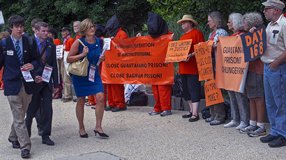 """Close Guantanamo Protest"" outside the US Senate Hart Building where hearings were held by the US Senate Judiciary Committee, The Constitution, Civil Rights and Human Rights Subcommittee hearing on ""Closing Guantanamo: The National Security, Fiscal, and Human Rights Implications."", July 24, 2013,  on Capitol Hill in Washington, DC. (AFP Photo / Paul J. Richards)"