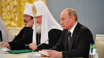 Russian President Vladimir Putin, right, and Patriarch of Moscow and All Russia Kirill (AFP Photo / Aleksey Nikolsky)