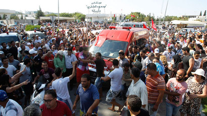 People walk beside the ambulance carrying the body of assassinated Tunisian opposition politician Mohamed Brahmi in Tunis July 25, 2013.(Reuters / Zoubeir Souissi)