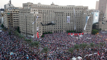 An Apache helicopter flies over Tahrir Square during a protest to support the army in Tahrir square in Cairo, July 26, 2013.(Reuters / Mohamed Abd El Ghany)
