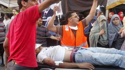 Supporters of deposed Egyptian President Mohamed Mursi help an injured protester, shot in the stomach, on a stretcher during clashes with police and Mursi opponents, in Nasr city area, east of Cairo July 27, 2013. (Reuters/Asmaa Waguih)