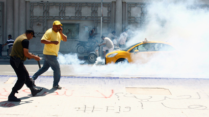 Police fire tear gas to break up a protest, near the parliament building in Tunis July 27, 2013 (Reuters / Zoubeir Souissi)