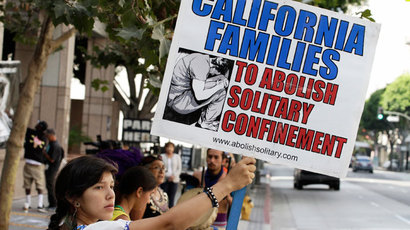 Karen Cuauhtemoc holds a sign during a rally supporting hunger strikers in the California prison system in Los Angeles, California July 29, 2013.(Reuters / Jonathan Alcorn)