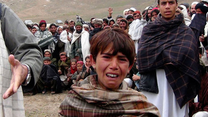 An Afghan boy cries during a funeral of members of his family in Logar province, March 27, 2013.(Reuters / Stringer)
