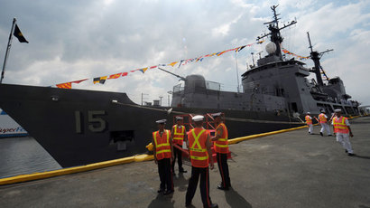 Philippine sailors stand in front of the newly-commissioned Hamilton-class cutter Gregorio del Pilar in Manila.(AFP Photo / Ted Aljibe)
