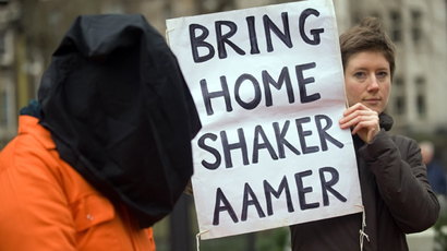 A protestor holds up a sign calling for the release of Shaker Aamer from the Guantanamo prison  (AFP Photo / Leon Neal)