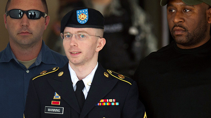 US Army Private First Class Bradley Manning leaves a military court facility after hearing his verdict in the trial at Fort Meade, Maryland on July 30, 2013. (AFP Photo / Saul Loeb)