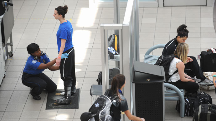 A passenger (L) is patted down by a Transportation Security Administration(TSA) agent (L) May 2, 2011 at Orlando International Airport in Orlando, Florida.(AFP Photo / Stan Honda)