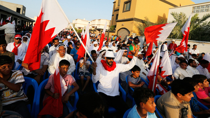 A protester waves a Bahraini flag as he flashes a victory sign during an anti-government protest organized by Bahrain's main opposition group Al Wefaq, in the village of Daih north of Manama (Reuters / Hamad I Mohammed)