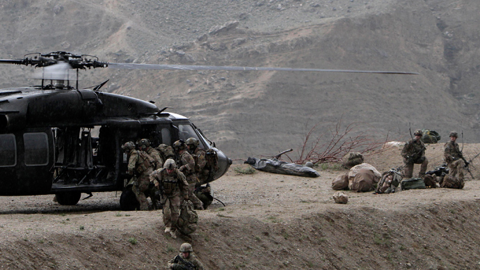 U.S soldiers carry the body of a fallen comrade into a helicopter near the scene of a helicopter crash in the Pachir Agam district of Nangarhar province (Reuters)