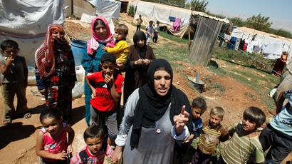 A Syrian refugee woman speaks to media at a camp in Terbol in the Bekaa Valley (Reuters)