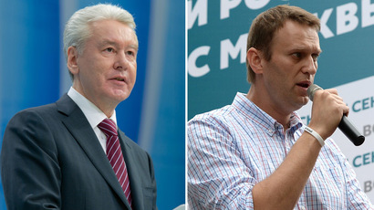 Acting Mayor of Moscow Sergei Sobyanin (L) and Aleksei Navalny (R), Moscow Mayor hopeful from the RPR-PARNAS Party (RIA Novosti)