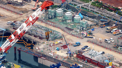 An aerial view shows workers wearing protective suits and masks work at a construction site (C) of the shore barrier to stop radioactive water from leaking into the sea at Fukushima Daiichi nuclear power plant on August 9, 2013. (Reuters/Kyodo)