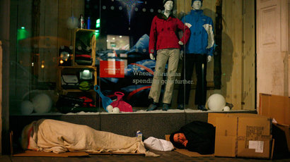 Homeless people sleep rough outside a shop, in central London.(Reuters / Eddie Keogh)
