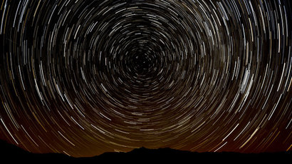 A multiple exposure picture taken in the early hours of August 11, 2013 shows a Perseids meteor shower in the sky, near the municipality of La Hiruela, on the mountains of the Sierra Norte de Madrid.(AFP Photo / Dani Pozo)