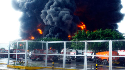Partial view of the refinery of Guaraguao after a fire broke when a lightning struck a treatment pond, in Puerto la Cruz, state of Anzoategui, 220 km east of Caracas, on August 11, 2013. (AFP Photo / Jose Manuel Rondon)