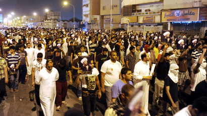 Protesters hold pictures of Sheikh Nimr al-Nimr during a rally at the coastal town of Qatif, against Sheikh Nimr's arrest July 8, 2012 (Reuters / Reuters / Amr Abdallah Dalsh)