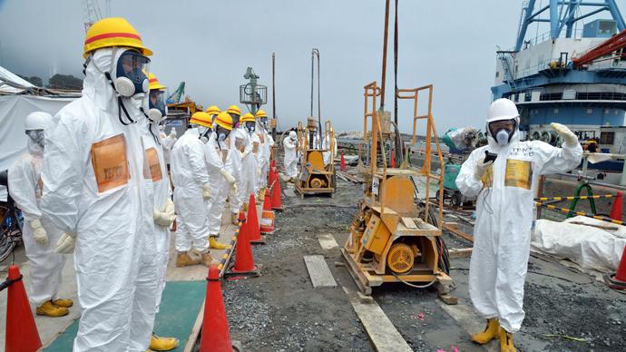 Contaminated mist: Workers at Fukushima 'sprayed' with radioactive water
