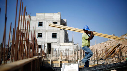 A labourer works on a construction site in Pisgat Zeev, an urban settlement in an area Israel annexed to Jerusalem after capturing it in the 1967 Middle East war August 12, 2013.(Reuters / Amir Cohen)