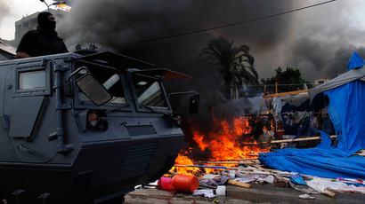 Egyptian security forces move in to disperse a protest camp held by supporters of ousted president Mohamed Morsi and members of the Muslim Brotherhood, on August 14, 2013 (AFP Photo / Str)