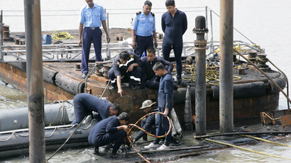 Indian Navy divers and personnel at the conning tower of the stricken INS Sindhurakshak, after the submarine sank following an explosion at the naval dockyard in Mumbai on August 14, 2013 (AFP Photo / Ministry of Defence)