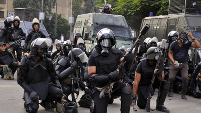 Egyptian riot police move in to disperse supporters of Egypt's deposed president Mohamed Morsi from a protest camp in Cairo's Al-Nahda square on August 14, 2013. (AFP Photo/Engy Imad)