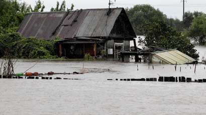 Flood waters sweep the Bolshoy Ussuriysky island near the city of Khabarovsk. (RIA Novosti/Vitaliy Ankov)