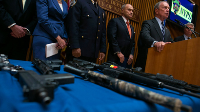 New York City mayor Michael Bloomberg (R) holds a news conference with seized guns at the police headquarters in New York August 19, 2013 (Reuters / Eric Thayer)