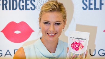 "Tennis player Maria Sharapova poses for photographers as she promotes her ""Sugarpova"" confectionary brand (Reuters / Neil Hall)"