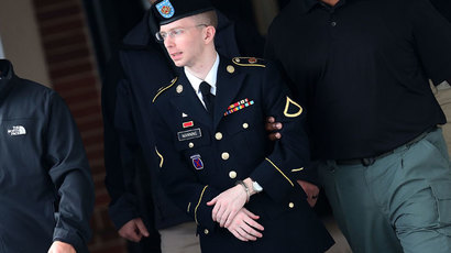 US Army Private First Class Bradley Manning is escorted out of a military court facilityÊduring the sentencing phase of his trial in Fort Meade, Maryland.(AFP Photo / Mark Wilson)