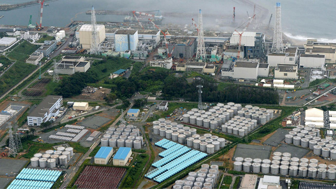 An aerial view shows Tokyo Electric Power Co. (TEPCO)'s tsunami-crippled Fukushima Daiichi nuclear power plant and its contaminated water storage tanks (bottom) in Fukushima, in this photo taken by Kyodo August 20, 2013. (Reuters/Kyodo)