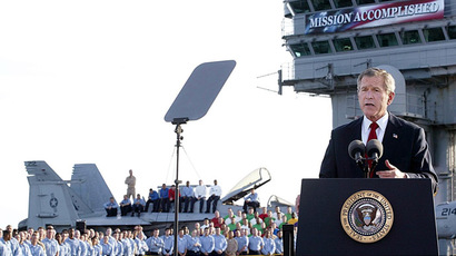 "US President George W. Bush addresses the nation aboard the nuclear aircraft carrier USS Abraham Lincoln 01 May, 2003. Bush declared major fighting over in Iraq, calling it ""one victory in a war on terror"" which he said would continue until terrorists are defeated.  (AFP Photo/Stephen Jaffe)"