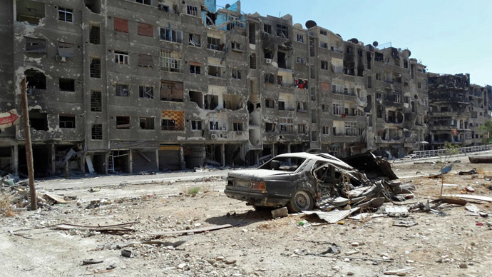 A handout image released by the Syrian opposition's Shaam News Network on August 17, 2013 shows heavily damaged buildings in Zamalka, a suburb of the Syrian capital Damascus. (AFP Photo)