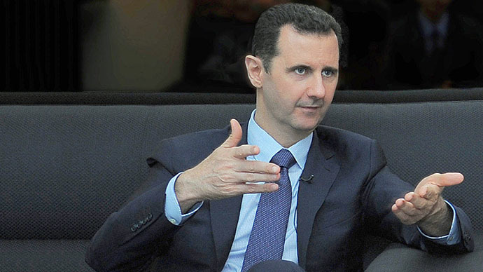 A handout picture released by the Syrian Arab News Agency (SANA) on August 26, 2013 shows Syrian President Bashar al-Assad giving an interview with Russian newspaper Izvestia in Damascus (AFP Photo)